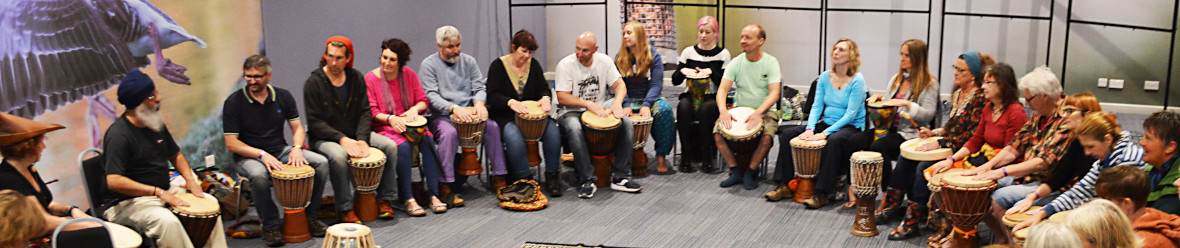 turtlelodgehealing.co.uk image: People enjoying a drumming workshop